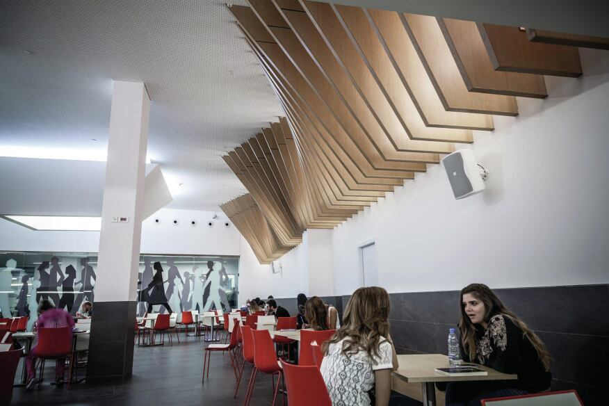 A series of wooden fins in the cafeteria create an interesting architectural detail while also helping to control noise levels in the space.