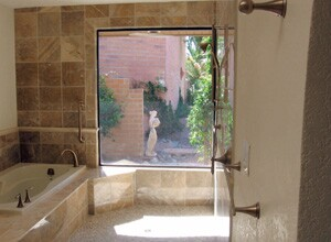 Like remodelers Bob Bell and Scott McCollum, Dakota Builders in Tucson, Ariz., also has taken on universal design projects. The bathroom project shown above features a spacious roll-in shower design well-suited not just for wheelchair access, but also for bathing kids or washing a dog.