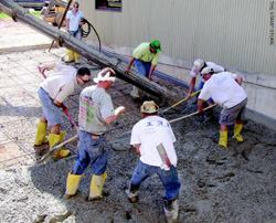 Placing concrete with the addition of steel fibers is a little more difficult but the addition of a superplasticizer or mid-range water reducer makes the job easier.