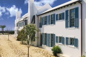 Project: Alys Beach Home, Alys Beach, Fla. Size: 2,400 square feet Cost: $1.999 million (listed price) Completed: May 2006 Certifications: IBHS Fortified…for safer living; Florida Green Building Coalition (Green Home Standard) Architect: Doug Farr Associates, Chicago Builder: Alys Beach Construction, Alys Beach General Contractor: Wave Construction, Panama City Beach, Fla. Interiors: Alys Beach Interiors, Alys Beach Town Planner: Duany Plater-Zyberk & Co., Miami  Developer: EBSCO Gulf Coast Development, Panama City Beach