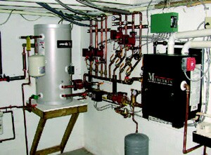 This remodel included a hot water tank (on the left) heated by a new sealed combustion boiler (on the right).