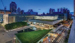 Overview of Lincoln Center Theater plaza at night.