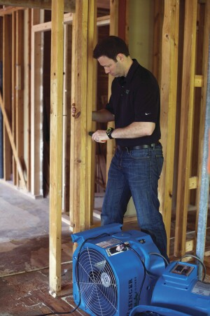 Many problems like open woodwork joints and drywall cracking can be attributed to framing moving as it dries and woodwork absorbing moisture during construction. To prevent these problems, Matt Risinger checks the moisture content of wood framing, not closing it up until it's near 12% MC, and using fans to get it there.