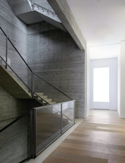 Light from above atrium stair filters into the open floors below.