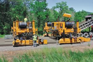 Hinkle Contracting is slipforming a concrete overlay on Interstate 59 in Etowah County with their paving train. The project features the zero-blanking band for measuring smoothness, and Hinkle's overall average has been under a 20.