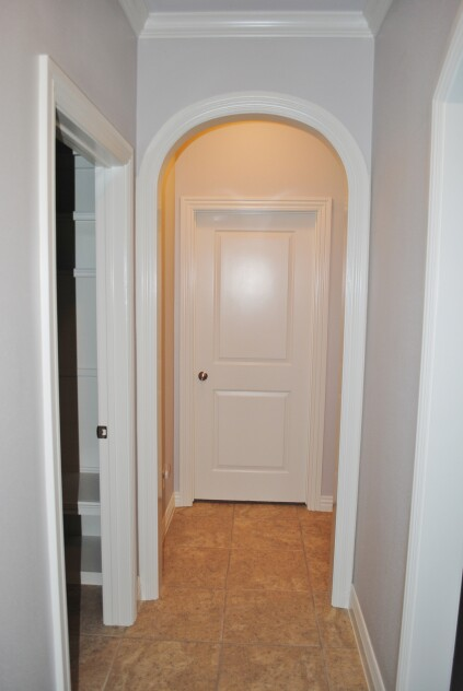 An elliptical arch needs less ceiling height than the circle top arch. Both attach to square cuts on side-jamb trim.