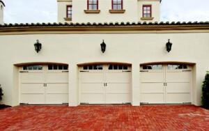 COURTYARD MANOR: Overhead Door Corp.'s Courtyard Collection custom doors adorn the garage. Designed  in the carriage-house style, the doors are made from steel and feature  full-depth polyurethane insulation. They are available in 18 designs and  with optional windows, decorative hardware, and a variety of colors. These  doors feature Wyndbridge-style windows.