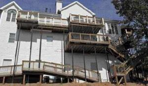 Figure 9. For decks elevated 13 or more feet, steel columns are needed to provide rigidity. Have the footings in place to determine column height before ordering.