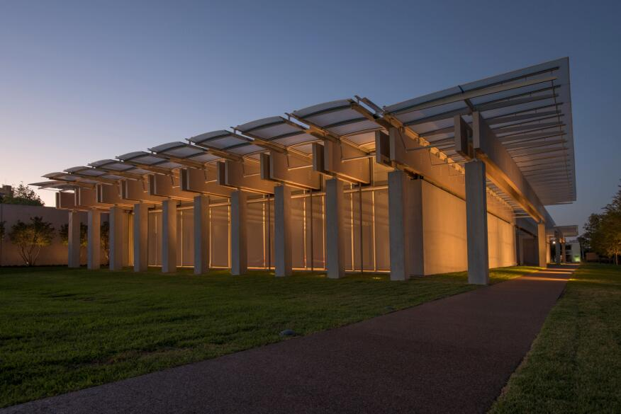 A nighttime view of the south façade of the new pavilion, with a view of the main, east façade looking north. Photographed September 2013.