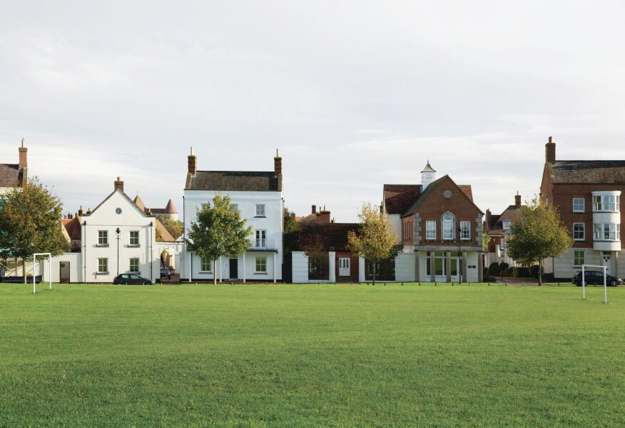 Poundbury's undeveloped space is concentrated at the town's edges, a green swathe of playing fields, gardens, and pastures.