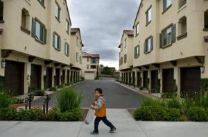 Josiah Almodovar, 3, outside the Doria apartments, an affordable housing complex in Irvine. His parents, Jose and Dionne Almodovar got on the waiting list two years ago and have been living there since 2011.
