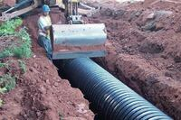 Corrugated HDPE pipe turns drainage ditch into living trail
