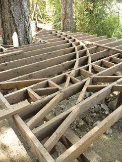 Figure 3. Blocking parallel to the joists for the long inlay on the upper deck was relatively simple (above), but blocking the curved section on the lower deck took a lot of layout and numerous individually cut pieces (below).