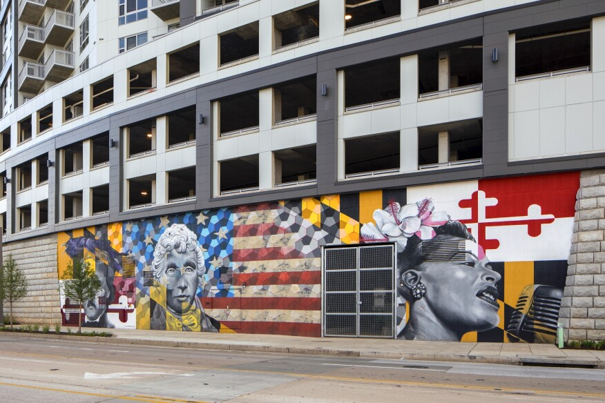A colorful, bold mural honoring local heroes Edgar Allen Poe, Francis Scott Key, and Billie Holiday adds a lively vibe to the building and reflects the developers' interest in showcasing local artists' work.