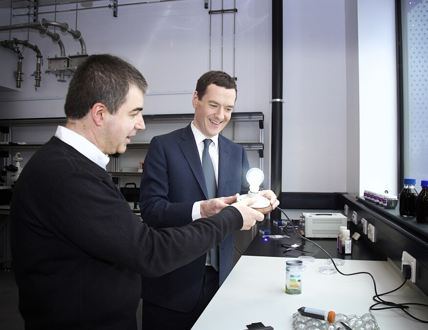 U.K. chancellor George Osborne (right) with Kostya Novoselov, a University of Manchester researcher who helped isolate graphene in 2004, with the graphene light bulb.