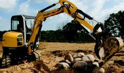 A track loader driver demonstrates one of the tasks that competitors will face  during the challenge.