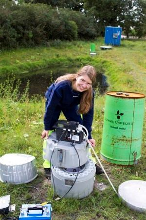 University of Southern Denmark Ph.D. candidate Melanie Sønderup collects water samples in order to test the absorption of their phosphorus content by crushed concrete.