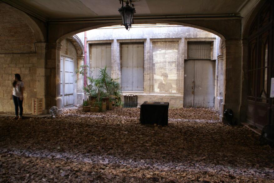 An installation recreating a previous autumn in a courtyard in summer, designed by Stefan Delvoye and Viktor Milletic of Paris-based Frame Squared.