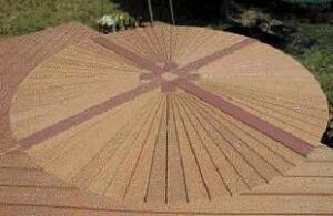 Figure 8. Wedge-shaped decking boards make up the fan pattern. Dividing the circle into quadrants with a cross pattern facilitates installation and creates a distinctive motif.