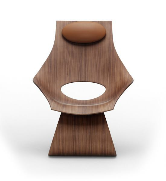 A walnut Dream Chair without upholstery.