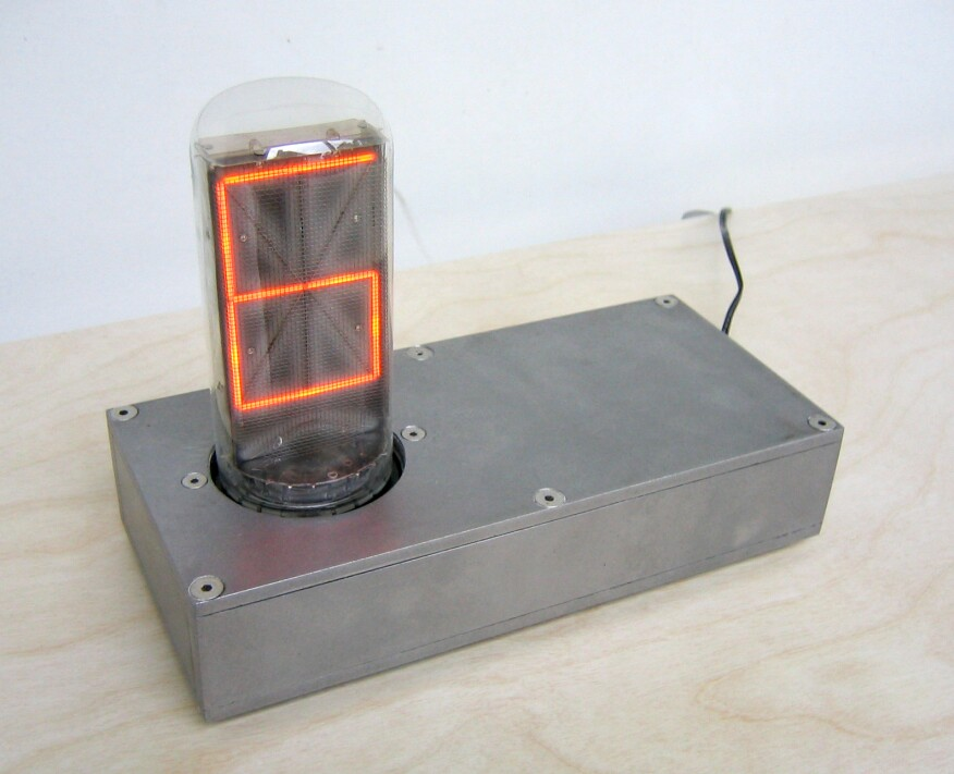 Made popular in the 1950s, Nixie tubes are electronic displays that predate LED technology. Awes programmed this one to function as a clock and added a simple steel-case stand.