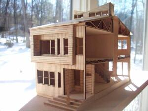 A scale model of Alexander Merlucci's townhouse design for Habitat for Humanity of Newark shows several of the concept's unique features, including an exterior planting box that frames the second-level windows and a central solar chimney.