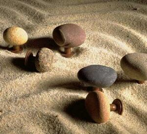 """BEACH BABES: Stones from the Pacific Ocean have found new life as cabinet hardware with the Old Souls Collection by Providence Artworks. The stones are offered in two distinct groups: bahia (Spanish for """"bay""""), which features basalt stones that are storm grey in color, and Arizona, which provides a mix of colors. The stone pulls in each group are naturally varied in size or shape and can be used in bathrooms and kitchens.  For more information, call 877-684-3362 or visit www.providenceartworks.com."""