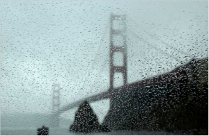 File - In this Jan. 5, 2016 file photo, rain drops bead on a car window below the Golden Gate Bridge in Sausalito, Calif. Nearly a dozen days of rain have doused Northern California this month and more soakings are in store before February rolls around, while Southern California more or less has gotten short-shrift from the El Nino-backed storms, forecasters said Thursday, Jan. 21. The storms aren't yet enough to end California's four-year dry spell. (AP Photo/Eric Risberg, File)