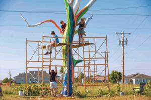 Dreams, Wings, and Beautiful Things Across a range of media, Joplin's artists have chronicled the community's rekindled hope and optimism. Above, artists paint a tornado-damaged tree in rainbow colors.