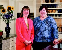 Susan Pierce (left) of Commonwealth Home Remodelers hired Sharon Smith to design kitchens at her company. Smith previously worked at The Home Depot.