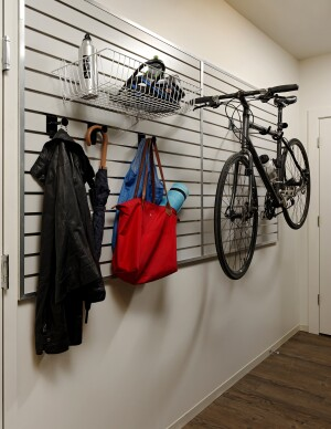 KTGY integrated gear walls into residents' units at its Washington, D.C., Ava H Street project. The walls can be configured to hang a bicycle or other objects of the tenant's choosing.