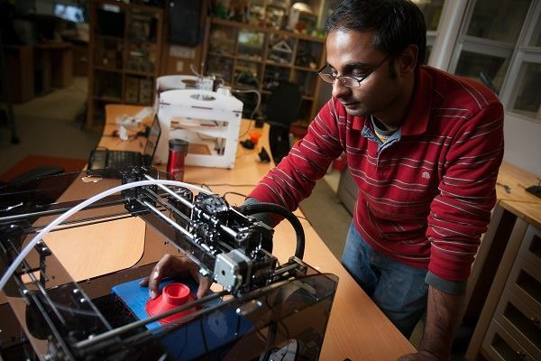 Cornell graduate engineering student Apoorva Kiran assembling one of two 3D printers used in the project.