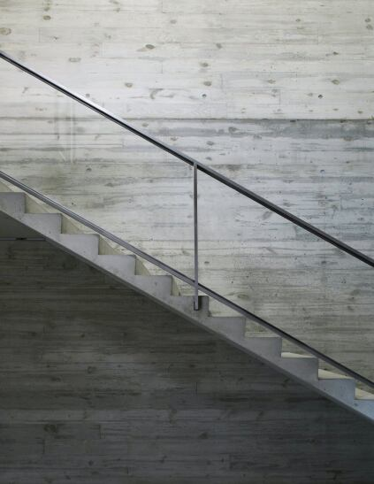 Board-formed concrete lines the interior stairwell.