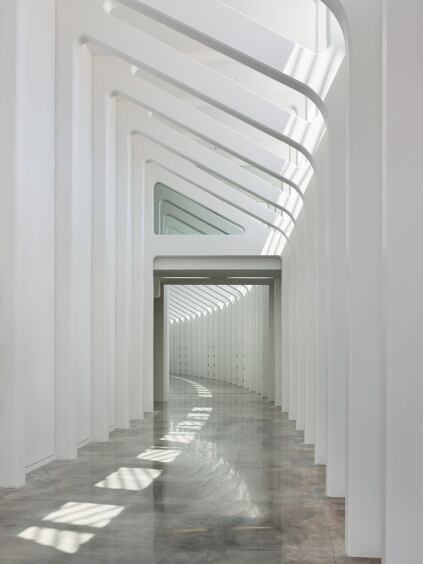 An interior corridor receives a similiar ribbed treatment to that of the exterior walkways.