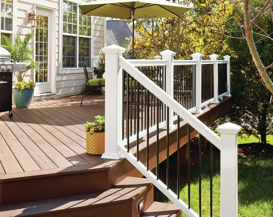 Fiberon Symmetry composite railings feature hidden mounting hardware and are available with black aluminum balusters (fiberondecking.com).