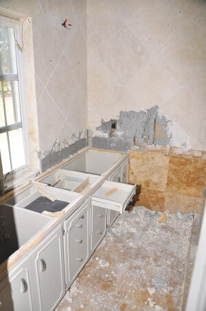 Step 1) Prep Work Deconstruction begins with the removal of products and materials that can be salvaged and reused, including light and plumbing fixtures, cabinets, doors, and major appliances.