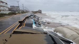 Waves washed away sand and undermined the asphalt along a short stretch of North Carolina Highway 12 in October.