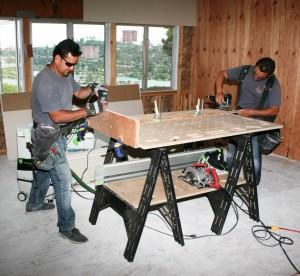 Multi-Function Slab bench top and shelf being used on site.