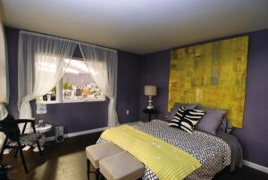 Generous windows flood the two bedrooms with natural light.