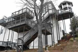Figure 2. Bringing stairs off the end of the deck saves floor space. Very high decks require landings between levels. Having the stairs reach the ground close to the house, where the grade is highest, keeps them as short as possible.