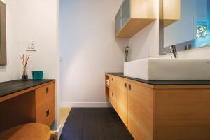Modern, clean-lined bathrooms feature low-flow toilets, faucets, and showerheads, as well as recycled paper countertops.
