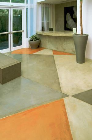 Zinc strips were used to create the geometric design on the floor. Four chemical stain colors were used to create a rich, warm tone throughout the project