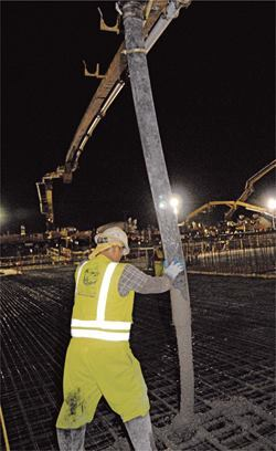 Long booms were used to place concrete for foundation mat slabs and topping slabs.