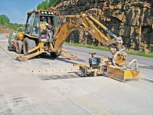 Highway full-depth repair often requires an equipment-mounted drill for mobility and productivity.