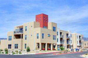 Desert Deal: Developed by El Paso, Texas-based Hunt Cos., ABQ Uptown Village features 198 urban-style loft apartments and amenities such as covered parking, a pool, granite countertops, specialty lighting, and mountain views.