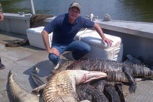 Senator David Vitter (R-Louisiana) poses with alligator carcasses after a gator hunt put on by a Political Action Committee to raise money for Vitter's re-election or a possible campaign for governor.