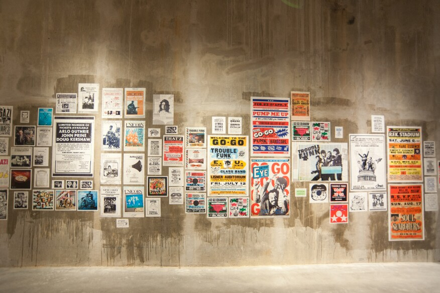 The corridor from the parking garage access to the stair is covered with posters honoring musicians and bands from D.C.'s go-go, punk, and bluegrass scenes, and curated in collaboration with Kip Lornell, an adjunct professor of music at George Washington University.