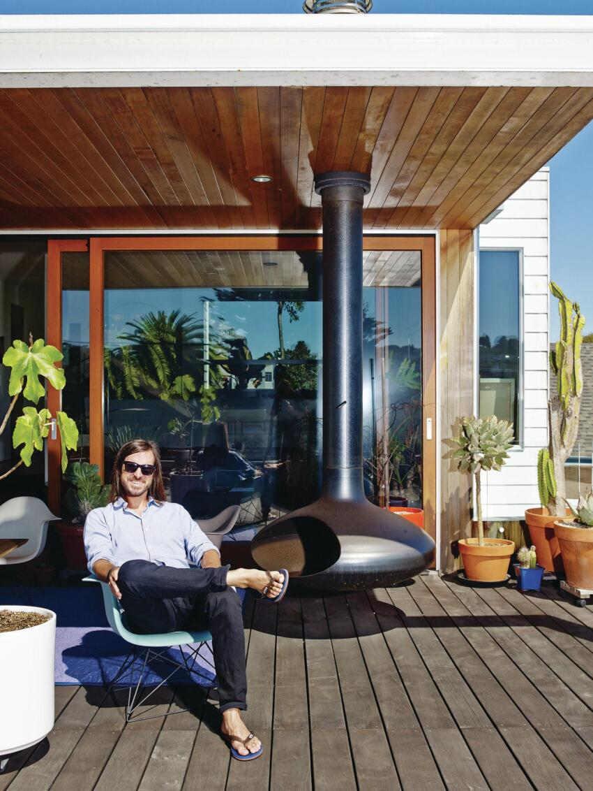 Craig Steely on the terrace of the living space that he designed for himself and his family in San Francisco.