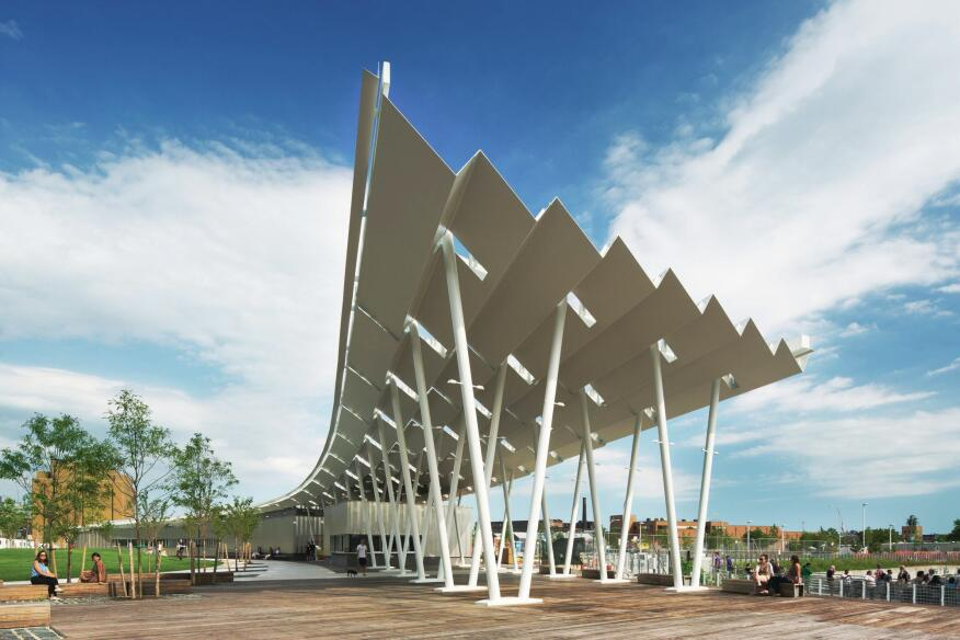 A pavilion with a pleated roof structure marks the ferry landing point on the site.