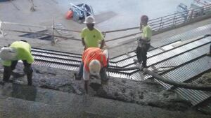 Elemix in concrete mixture reduced slump loss and allowed Albanelli Cement Contractors to use a 3-in. hose for placement.